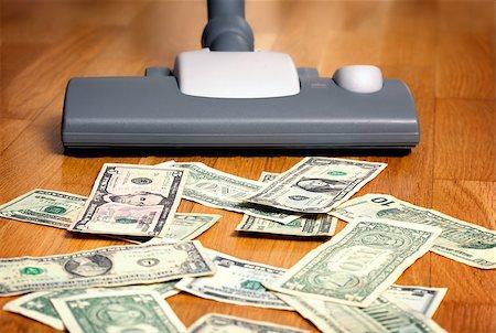 Vacuum cleaner sucks on U.S. dollars Stock Photo - Budget Royalty-Free & Subscription, Code: 400-07428457