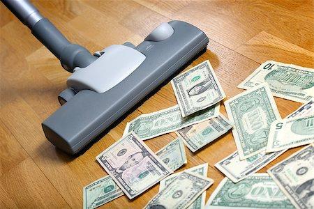 Vacuum cleaner sucks on U.S. dollars Stock Photo - Budget Royalty-Free & Subscription, Code: 400-07428458