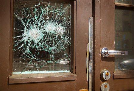 Broken window on  door by vandalism Stock Photo - Budget Royalty-Free & Subscription, Code: 400-07428463