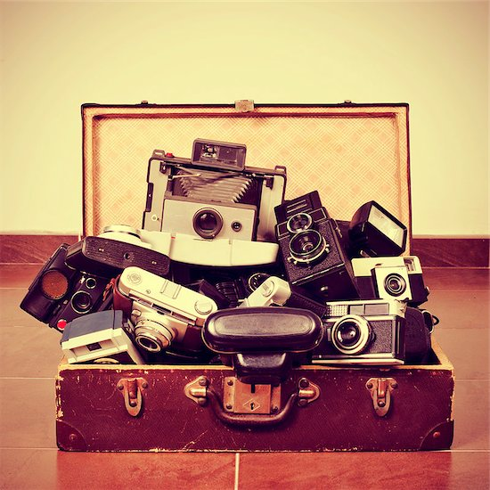 picture of a pile of old cameras in an old suitcase, with a retro effect Stock Photo - Royalty-Free, Artist: nito, Image code: 400-07421277