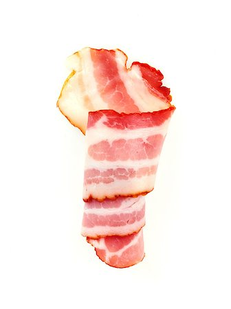 Fresh Sliced Pork Bacon isolated on white background Stock Photo - Budget Royalty-Free & Subscription, Code: 400-07423038