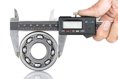 Metal vernier caliper and Ball bearings on white background Stock Photo - Budget Royalty-Free & Subscription, Code: 400-07450245