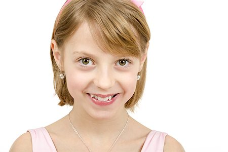 Studio portrait of young smiling beautiful girl with nice eyes on white background Stock Photo - Budget Royalty-Free & Subscription, Code: 400-07466109