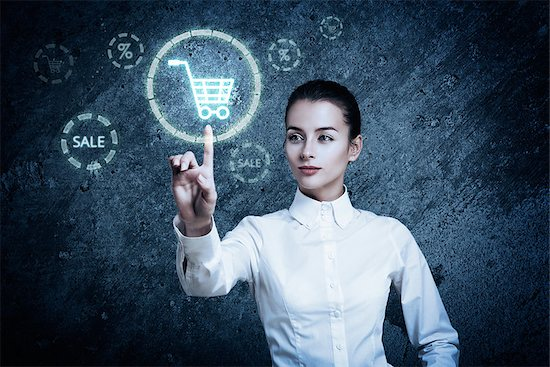 Beautiful Woman Pointing at Glowing Shopping Cart Icon. Perfect Online Shopping Business Concept Stock Photo - Royalty-Free, Artist: brickrena, Image code: 400-07461445