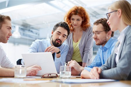 pressmaster (artist) - Angle view of a business team discussing the future of their company on the foreground Stock Photo - Budget Royalty-Free & Subscription, Code: 400-07462647