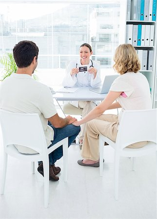 Expectant couple consulting female doctor in clinic Stock Photo - Budget Royalty-Free & Subscription, Code: 400-07473274