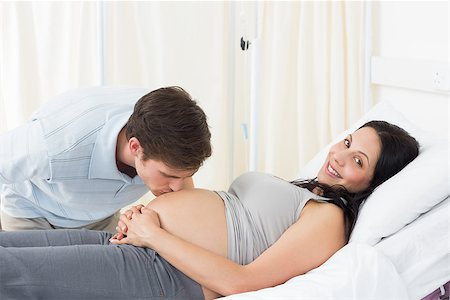 Man kissing on stomach of pregnant woman in hospital Stock Photo - Budget Royalty-Free & Subscription, Code: 400-07473333