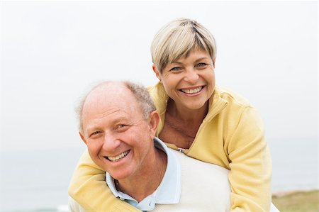 Smiling happy aged couple having fun in beach Stock Photo - Budget Royalty-Free & Subscription, Code: 400-07480702