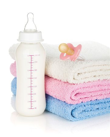 Baby bottle, pacifier and towels. Isolated on white background Stock Photo - Budget Royalty-Free & Subscription, Code: 400-07481711