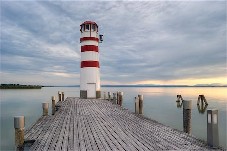 podersdorf - lighthouse at Lake Neusiedl at sunset near Podersdorf, Burgenland, Austria Foto de stock - Super Valor sin royalties y Suscripción, Código: 400-07482726