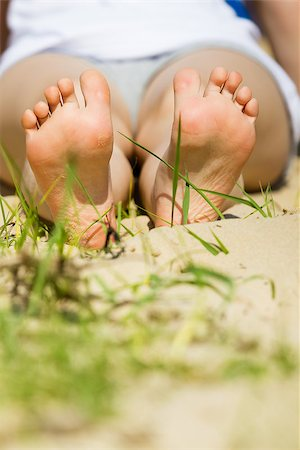 pzromashka (artist) - children's feet on a sandy beach in summer Stock Photo - Budget Royalty-Free & Subscription, Code: 400-07505771