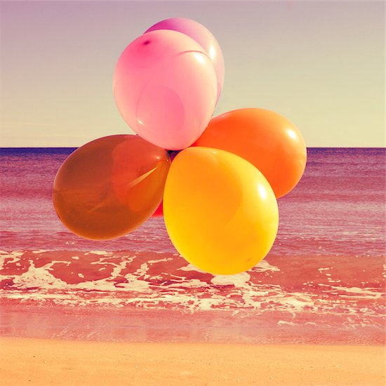 picture of a bunch of balloons of different colors flying in the sky over the ocean, with a retro effect Stock Photo - Royalty-Free, Artist: nito, Image code: 400-07508228