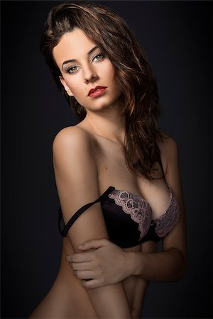 fashion model wearing a nice lace bra lingerie , looking in camera sensual with great hair style Stock Photo - Budget Royalty-Free & Subscription, Code: 400-07508461