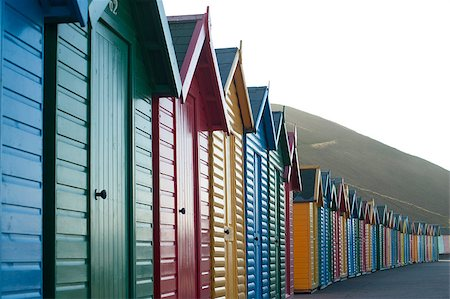 Row of colorful wooden beach huts overlooking Whitby Sands in North Yorkshire looking along the front facades of the receding line of huts Stock Photo - Budget Royalty-Free & Subscription, Code: 400-07508551