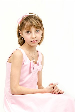 Studio portrait of young beautiful girl with nice eyes on white background Stock Photo - Budget Royalty-Free & Subscription, Code: 400-07509444