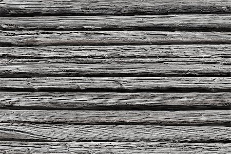 Wall of old weathered logs with cracks, black and white Stock Photo - Budget Royalty-Free & Subscription, Code: 400-07501663