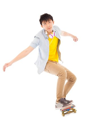 young man Skateboard to jump isolated on white background Stock Photo - Budget Royalty-Free & Subscription, Code: 400-07518047