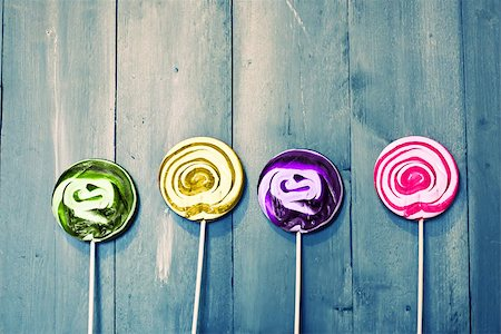 swirly - Photo of 4 lollipops on wooden Stock Photo - Budget Royalty-Free & Subscription, Code: 400-07549543