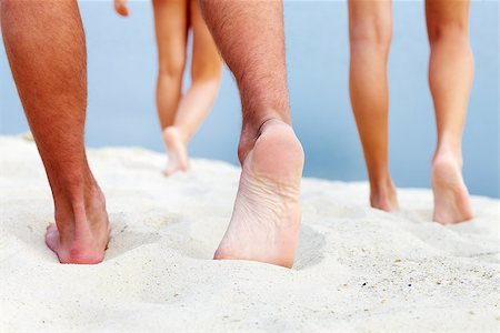 Soles of teenagers walking down sandy beach Stock Photo - Budget Royalty-Free & Subscription, Code: 400-07552208