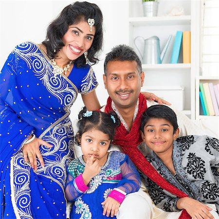 Portrait of Asian Indian family at home, happy parents and children in traditional sari. Stock Photo - Budget Royalty-Free & Subscription, Code: 400-07553669