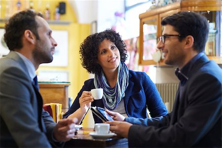 diego_cervo (artist) - People at bar with team of colleagues meeting in cafeteria, working with ipad and drinking coffee Stock Photo - Budget Royalty-Free & Subscription, Code: 400-07553777