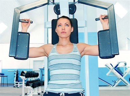 sweaty woman - Woman is engaged in fitness club on the simulator Stock Photo - Budget Royalty-Free & Subscription, Code: 400-07568411