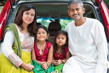 Happy Asian Indian family sitting in car, ready to summer vacation. Stock Photo - Budget Royalty-Free & Subscription, Code: 400-07574752