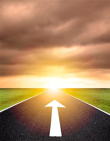 the ahead arrow on the asphalt road  and sunset background Stock Photo - Budget Royalty-Free & Subscription, Code: 400-07575382