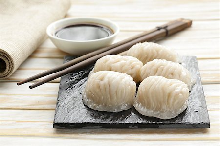 dumplings steamer - Asian steamed meat dumplings dim sum with soy sauce Stock Photo - Budget Royalty-Free & Subscription, Code: 400-07576161
