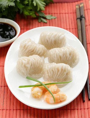 dumplings steamer - Asian steamed meat dumplings dim sum with soy sauce Stock Photo - Budget Royalty-Free & Subscription, Code: 400-07576162
