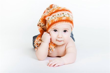 pzromashka (artist) - Studio photography. Little baby boy in a knitted hat posing Stock Photo - Budget Royalty-Free & Subscription, Code: 400-07577274