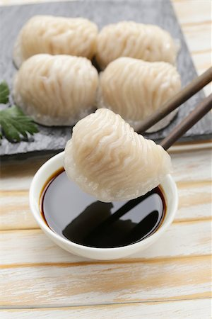 dumplings steamer - Asian steamed meat dumplings dim sum with soy sauce Stock Photo - Budget Royalty-Free & Subscription, Code: 400-07577475