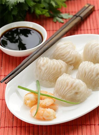 dumplings steamer - Asian steamed meat dumplings dim sum with soy sauce Stock Photo - Budget Royalty-Free & Subscription, Code: 400-07577476