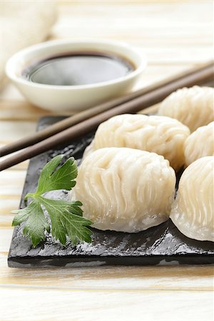 dumplings steamer - Asian steamed meat dumplings dim sum with soy sauce Stock Photo - Budget Royalty-Free & Subscription, Code: 400-07577472