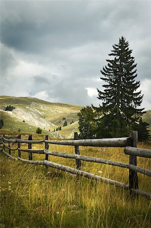 road landscape - Old fence in the mountain Stock Photo - Budget Royalty-Free & Subscription, Code: 400-07570755