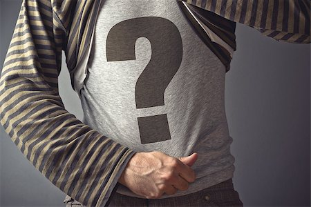 Questioning concept. Casual man showing question mark printed on his shirt. Stock Photo - Budget Royalty-Free & Subscription, Code: 400-07571745