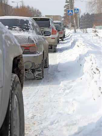 Snowy road surface from the back of unrecognizable car Stock Photo - Budget Royalty-Free & Subscription, Code: 400-07573770
