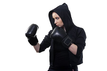 pzromashka (artist) - Young serious woman in boxing gloves on a white background Stock Photo - Budget Royalty-Free & Subscription, Code: 400-07584634