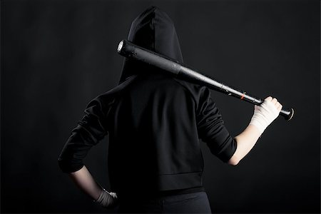 pzromashka (artist) - Young woman with a baseball bat. View from the back. street hoodlum Stock Photo - Budget Royalty-Free & Subscription, Code: 400-07584631