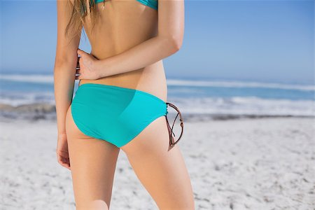 simsearch:400-04002563,k - Rear view of fit woman in bikini on beach on a sunny day Stock Photo - Budget Royalty-Free & Subscription, Code: 400-07582442
