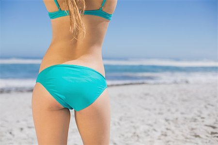 simsearch:400-04002563,k - Rear view of fit woman in bikini on beach on a sunny day Stock Photo - Budget Royalty-Free & Subscription, Code: 400-07582454