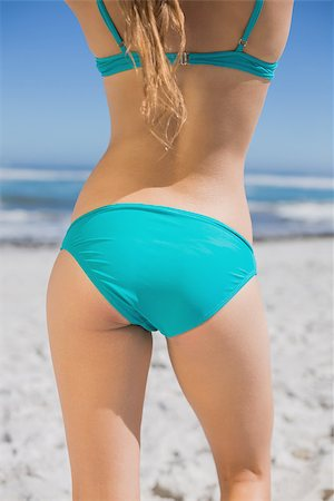 simsearch:400-04002563,k - Rear view of fit woman in bikini on beach on a sunny day Stock Photo - Budget Royalty-Free & Subscription, Code: 400-07582453