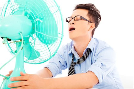 sweaty businessman - business man  suffering a hot  summer heat with fans Stock Photo - Budget Royalty-Free & Subscription, Code: 400-07619017