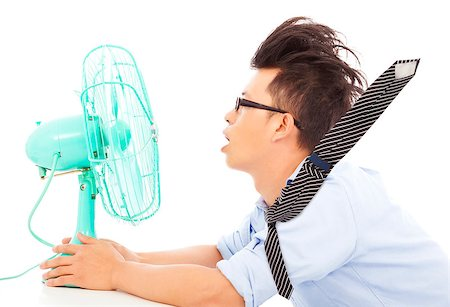 sweaty businessman - Summer heat, business man use fans to cool down Stock Photo - Budget Royalty-Free & Subscription, Code: 400-07619018