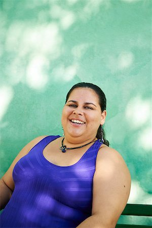 diego_cervo (artist) - Portrait of overweight hispanic woman looking at camera and smiling Stock Photo - Budget Royalty-Free & Subscription, Code: 400-07619097