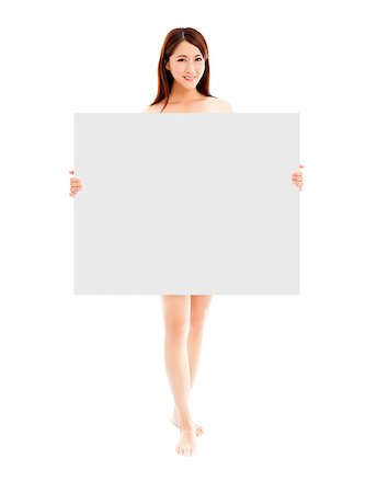 Beautiful young sexy woman holding a empty white board Stock Photo - Budget Royalty-Free & Subscription, Code: 400-07624487