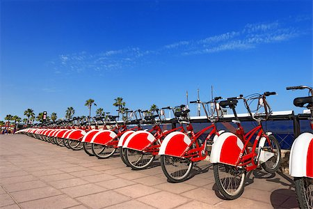 Long row of red and white bicycles (public bikes) near the harbor in Ronda Litoral, Barcelona - Spain Stock Photo - Budget Royalty-Free & Subscription, Code: 400-07626989