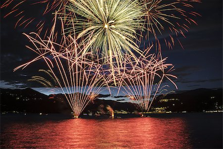 silhouette of firework - Lakefront Luino fireworks on the Maggiore lake in summer evening, Lombardy - Italy Stock Photo - Budget Royalty-Free & Subscription, Code: 400-07628051