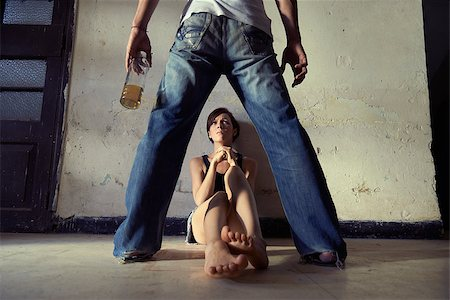 diego_cervo (artist) - People, substance abuse and domestic violence. Drunk man standing with whiskey bottle and threatening his young wife at home Stock Photo - Budget Royalty-Free & Subscription, Code: 400-07620796