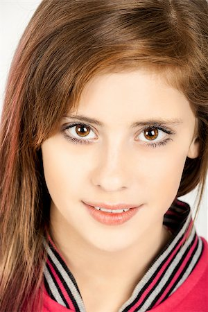 Studio fashion portrait of young beautiful girl with nice eyes on white background Stock Photo - Budget Royalty-Free & Subscription, Code: 400-07621048